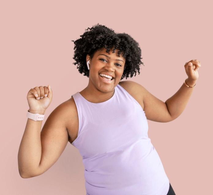 black curvy woman smiling, workout clothes