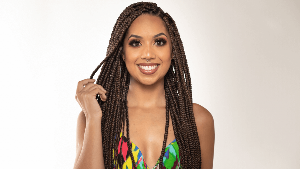 Black woman smiling with Box Braids hair style