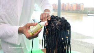 Woman moisturizing scalp