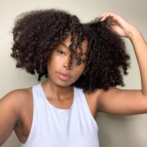 black woman with natural curly hair