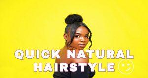 Black girl with natural updo bun